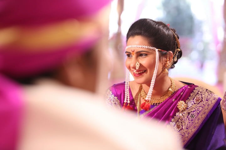 Candid Dhot Of Marathi Bride Highlighting Her Conventional Marathi Headpiece And Nath by Sameer Panchpor Wedding-photography | Weddings Photos & Ideas