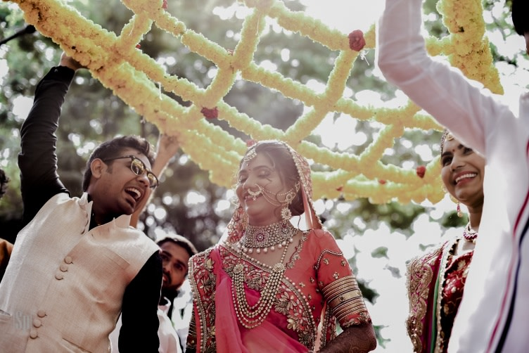 Candid Shot Of Gorgeous Bride Arriving Under The Phool Chadar by Sameer Panchpor Wedding-photography | Weddings Photos & Ideas
