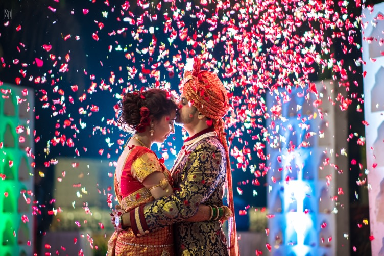 Enthralling Glimpse Of Bride And Groom Being Showered By Rose Petals by Sameer Panchpor Wedding-photography | Weddings Photos & Ideas
