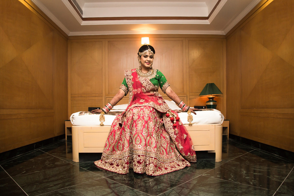 Stunning Red Bridal Lehenga With Golden Motifs And Green Blouse For A Conventional Bridal Look by Nikhil Y. Bharane Wedding-photography Wedding-dresses | Weddings Photos & Ideas