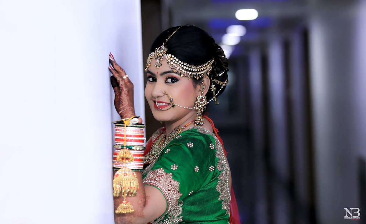 Light And Natural Makeup With Bold Eyes Going Well With The Multi-Colored Kundan Jewellery by Nikhil Y. Bharane Wedding-photography Bridal-jewellery-and-accessories Bridal-makeup | Weddings Photos & Ideas