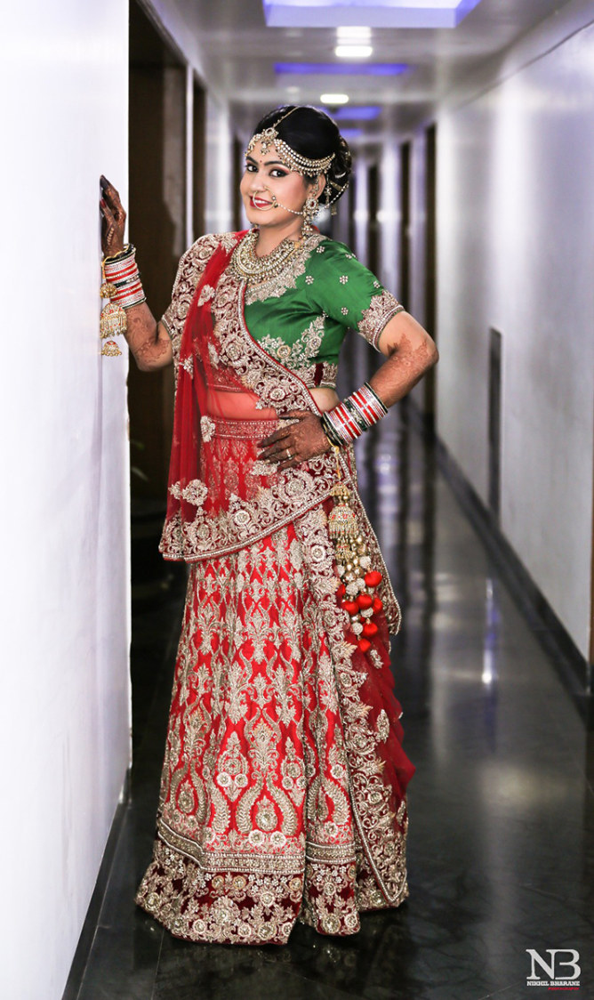 Cherry Red Lehenga Embellished With Heavy Silver Zardozi Work And Green Choli And Garmet Red Net Dupatta by Nikhil Y. Bharane Wedding-photography Wedding-dresses | Weddings Photos & Ideas