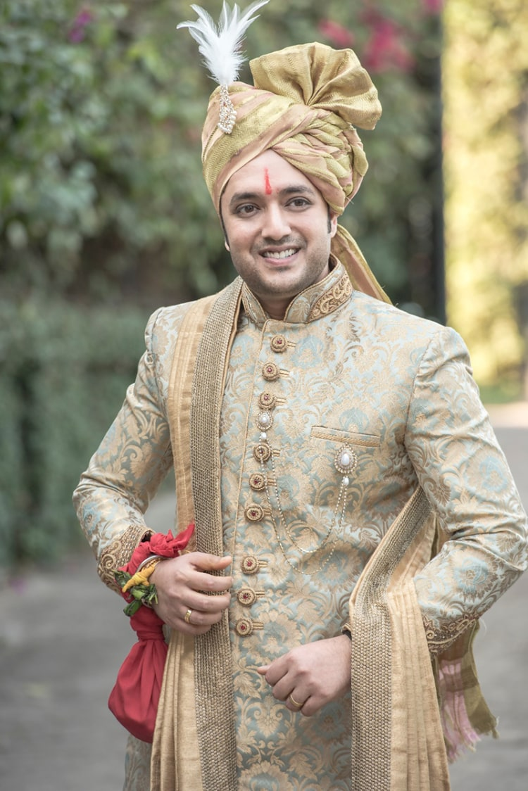 Golden Intricate High Collared Sherwani With Delicate Round Buttons Completing Its Look By Golden Turban With Feathered Kilangi Brooch by Nikhil Y. Bharane Wedding-photography Groom-wear-and-accessories | Weddings Photos & Ideas
