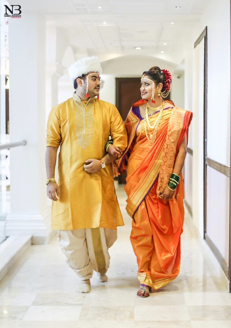 Yellow Kurta And Dhoti With Golden Work On Collar Neck For Groom And Orange Silken Saree With Golden Borders For Bride by Nikhil Y. Bharane Wedding-photography Groom-wear-and-accessories | Weddings Photos & Ideas