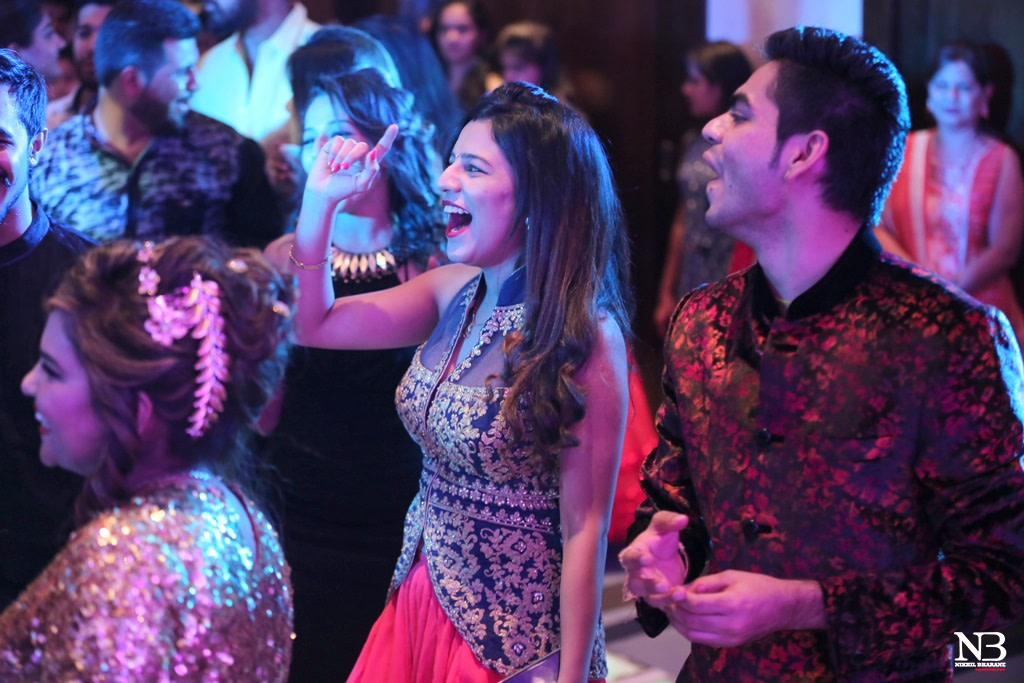 Candid Shot Of Wedding Guests Swaying On The Dance Floor by Nikhil Y. Bharane Wedding-photography | Weddings Photos & Ideas