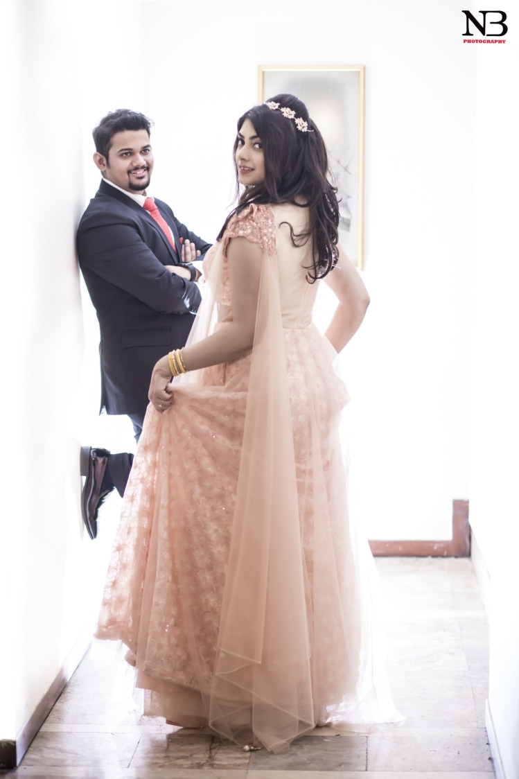 Back Shot Of Bride Flaunting Her Peach Engagement Lehenga by Nikhil Y. Bharane Wedding-photography | Weddings Photos & Ideas
