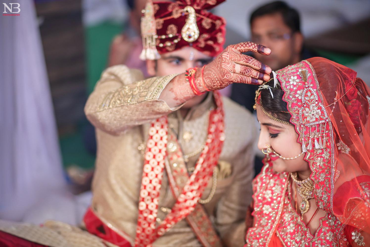 Candid Shot Of Bridegroom During The Sindoor Ceremony by Nikhil Y. Bharane Wedding-photography | Weddings Photos & Ideas