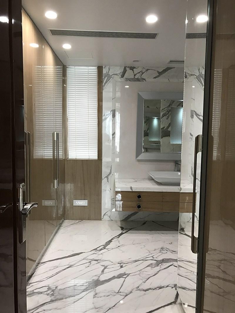 Design of a modern bathroom with marble flooring by SA Design Group Bathroom Modern | Interior Design Photos & Ideas