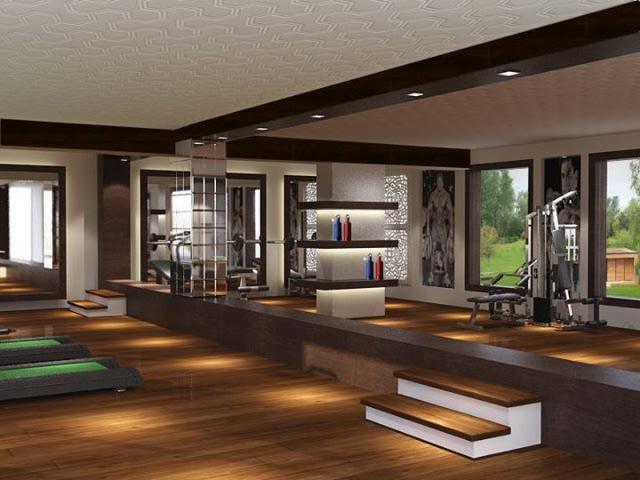 Spacious home gym with wooden flooring by SA Design Group Modern | Interior Design Photos & Ideas