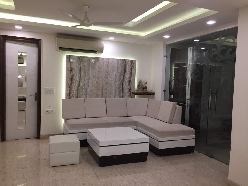 Square Shape Center Table With L-Shaped Sofa In Living Room by Amit Sharma Living-room Minimalistic | Interior Design Photos & Ideas