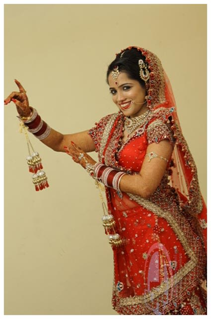 Fun Bride Pose by The Action Photography Wedding-photography | Weddings Photos & Ideas