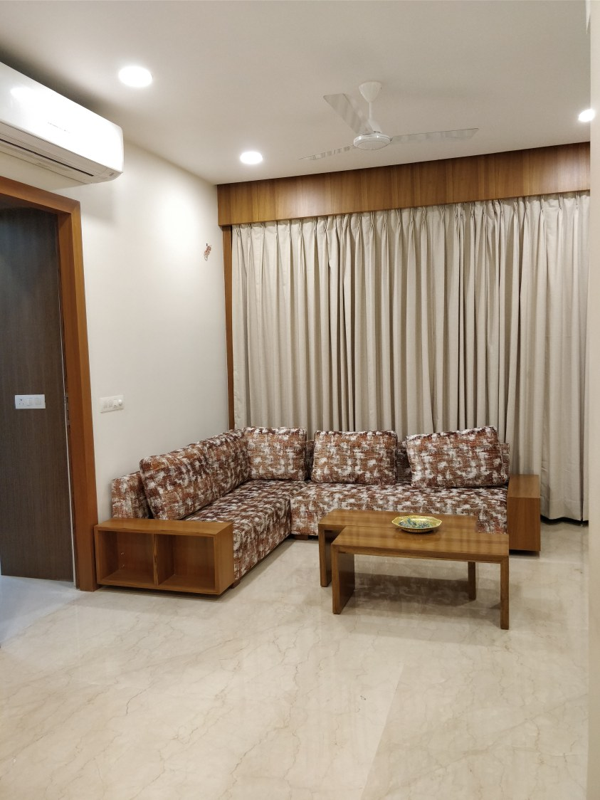 Patterned Sectional Sofa With Wooden Table by Ankil Desai Living-room Modern | Interior Design Photos & Ideas