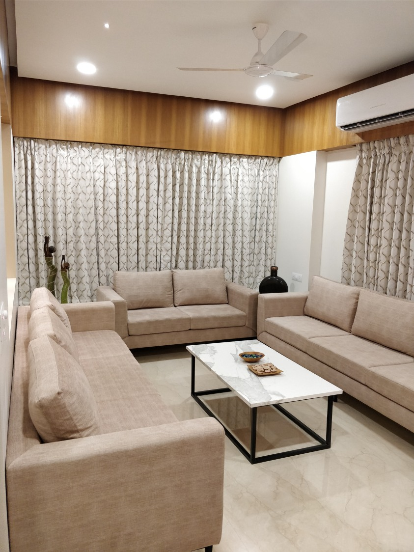 Beige Colored Sofa With Marble Top Centre Table by Ankil Desai Living-room Modern | Interior Design Photos & Ideas