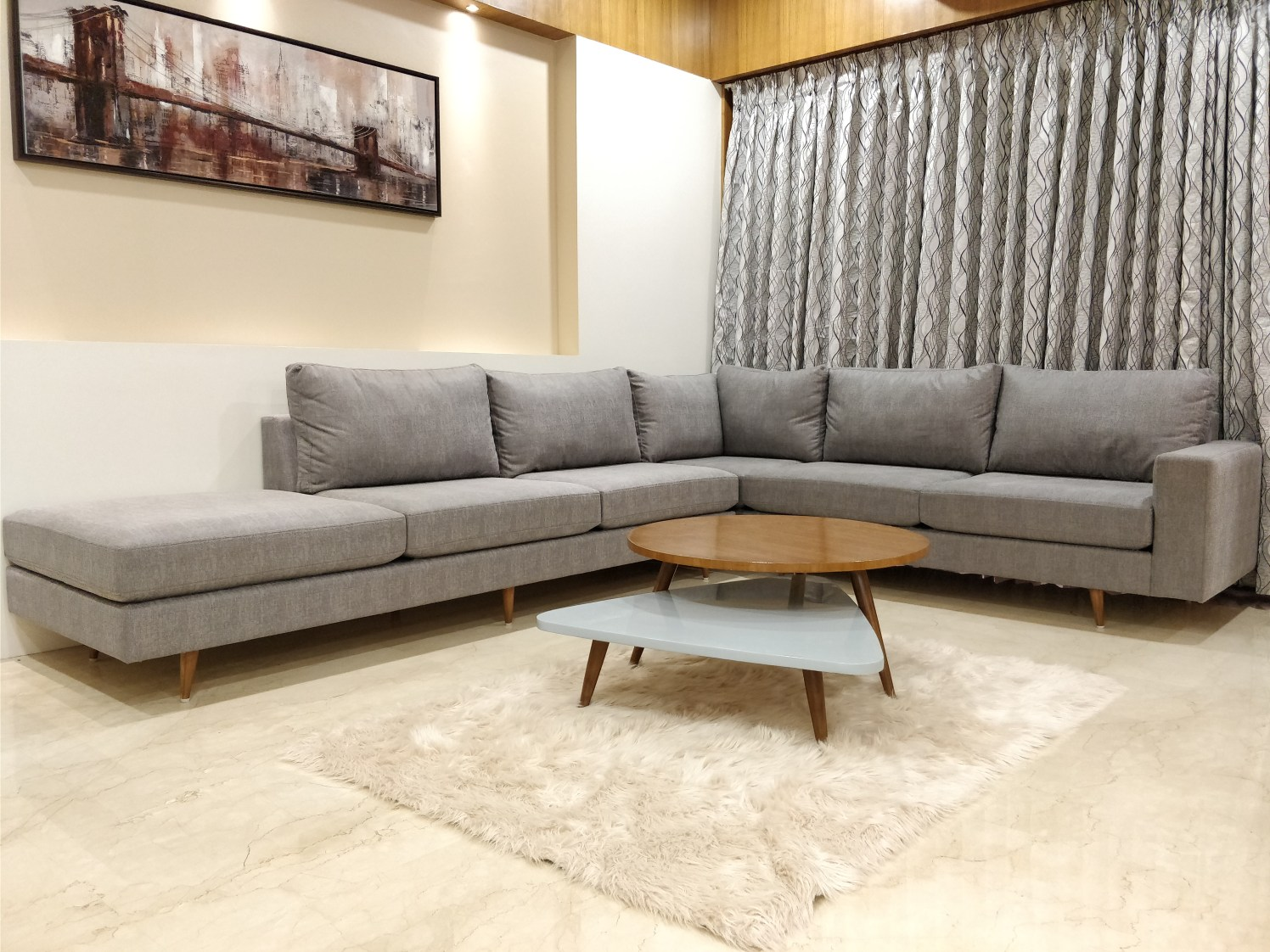 Grey Sectional Sofa With Wooden Centre Table And Soft Rug by Ankil Desai Living-room Modern | Interior Design Photos & Ideas