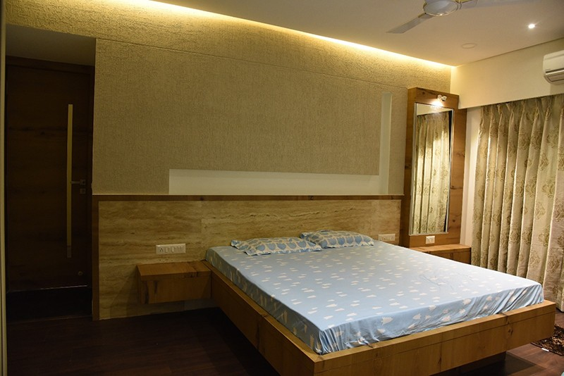 Wooden Low Rise Bed With Textured Walls by Ankil Desai Bedroom Modern | Interior Design Photos & Ideas