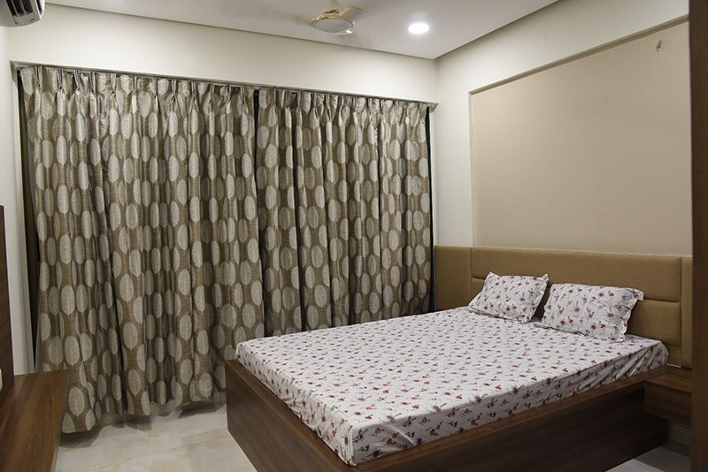 Queen Size Bed With Patterned Curtains For Bedroom Space by Ankil Desai Bedroom Modern | Interior Design Photos & Ideas