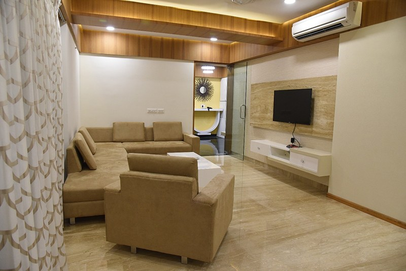 Tan Colored Sectional Sofa With Marbel Flooring by Ankil Desai Living-room Modern | Interior Design Photos & Ideas