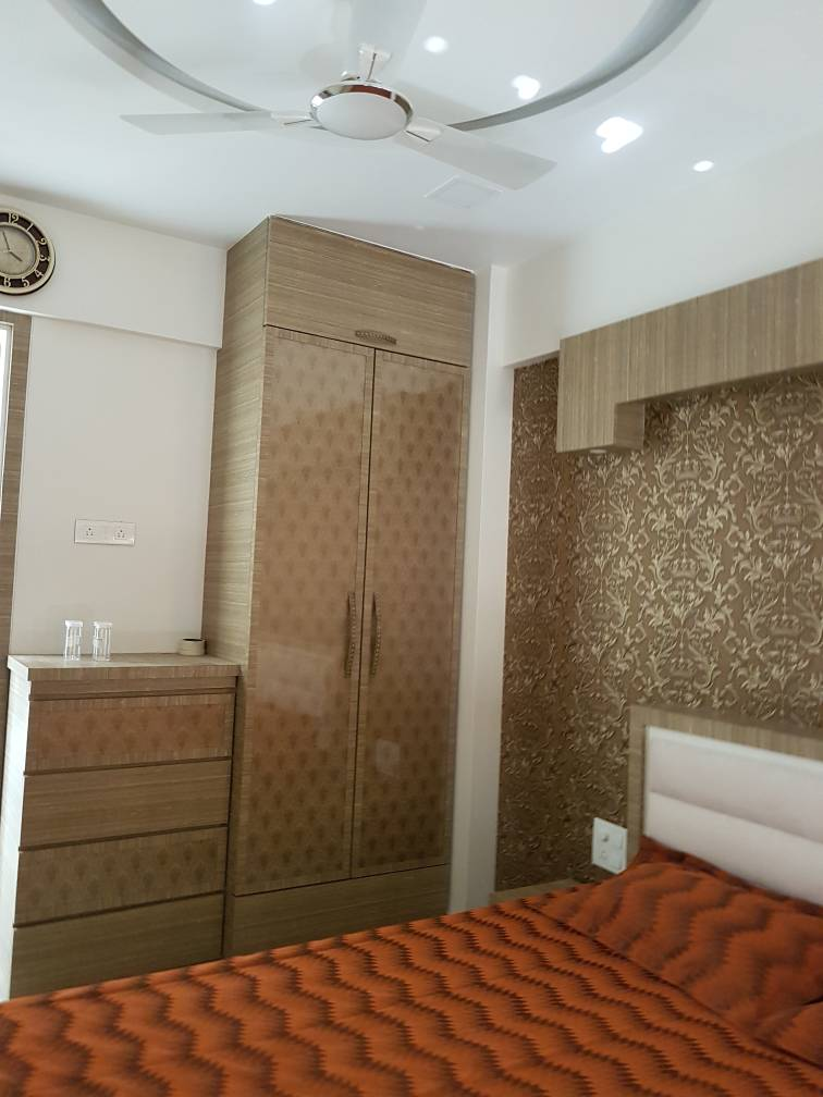 Beige Wardrobe And Artistic Wall-art In Vintage Bedroom by Vijay Bedroom Contemporary | Interior Design Photos & Ideas