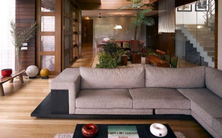 Premium Wooden Living Room with Plants by Eureka Interiors Living-room Contemporary | Interior Design Photos & Ideas