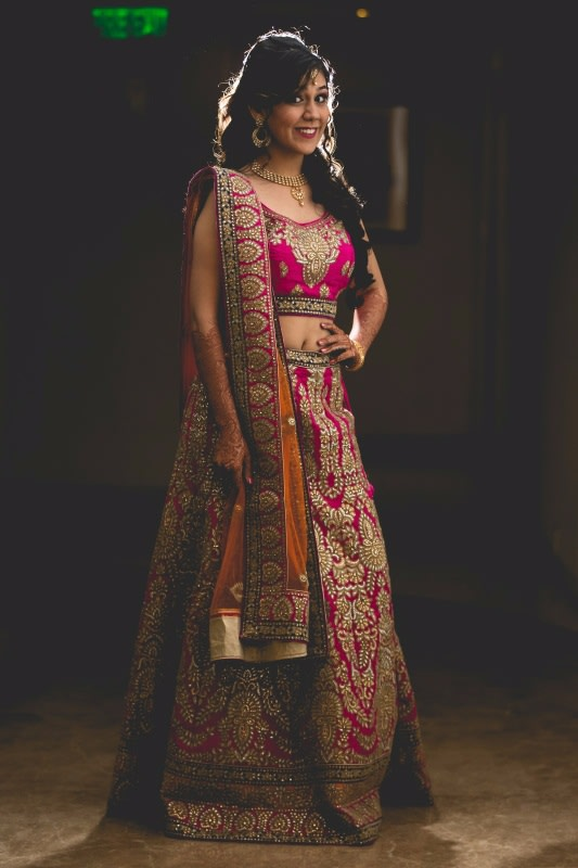 posing in a beautiful pink lehenga by A Story Perhaps  Wedding-photography | Weddings Photos & Ideas