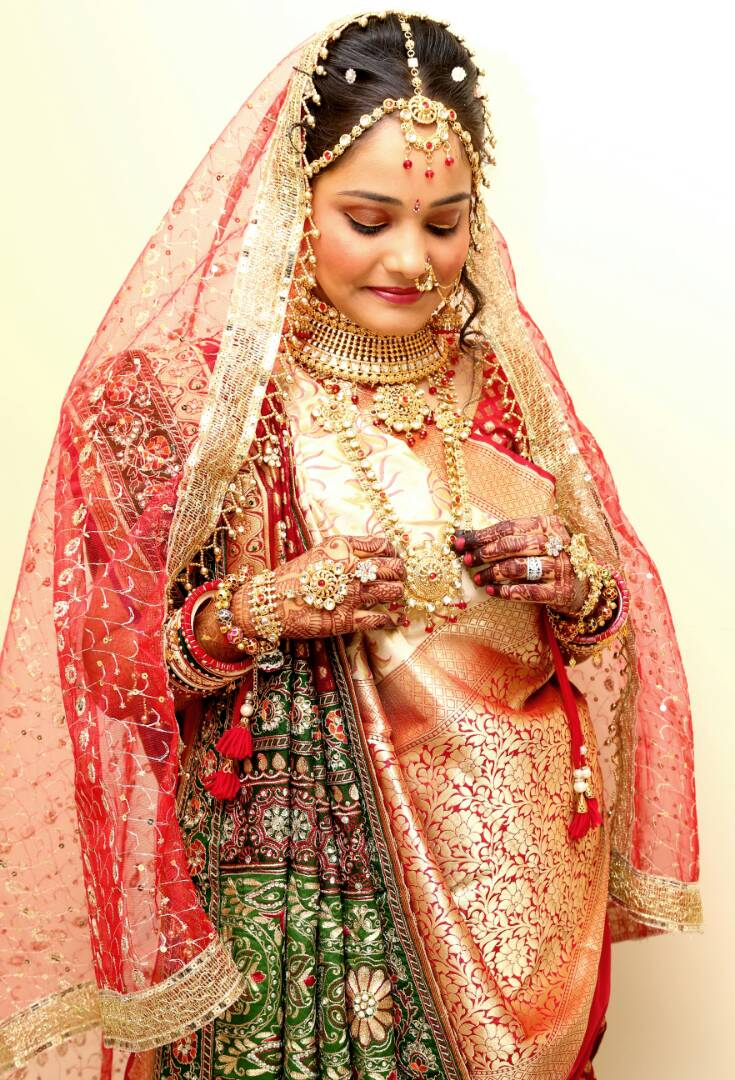 The bride admiring her gold jewellery by Proffesional Photographer Wedding-photography | Weddings Photos & Ideas