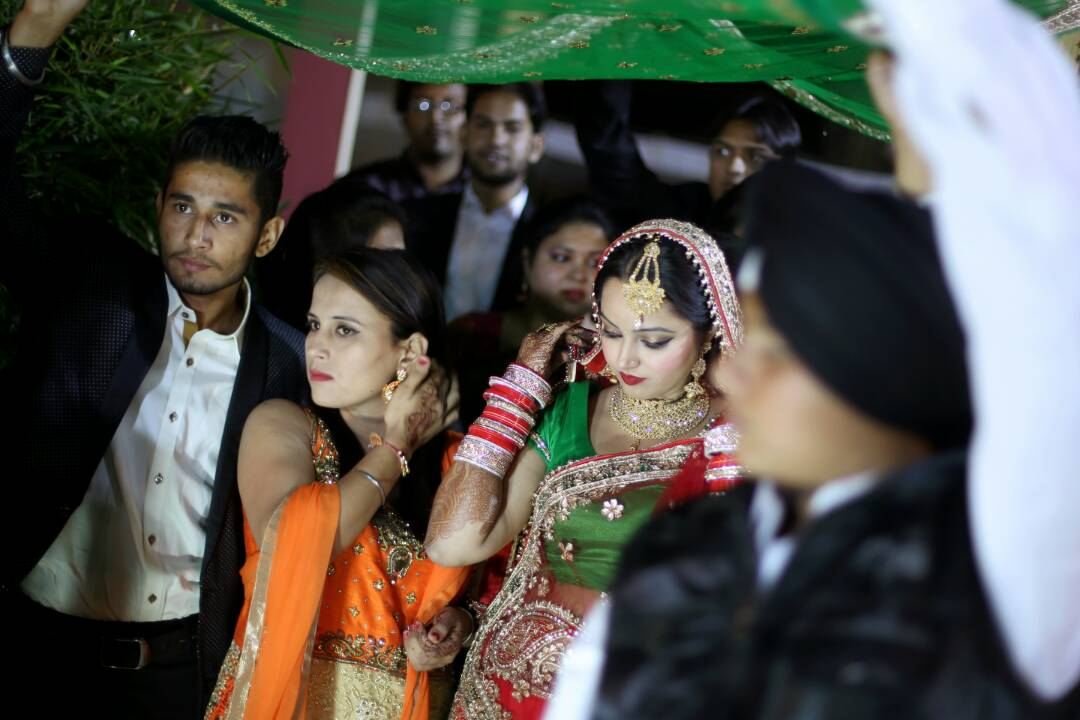 The bride walking with her relatives by Proffesional Photographer Wedding-photography | Weddings Photos & Ideas