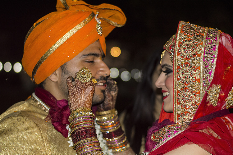 The wedding couple enjoying a candid moment by Exprezzions Wedding-photography | Weddings Photos & Ideas
