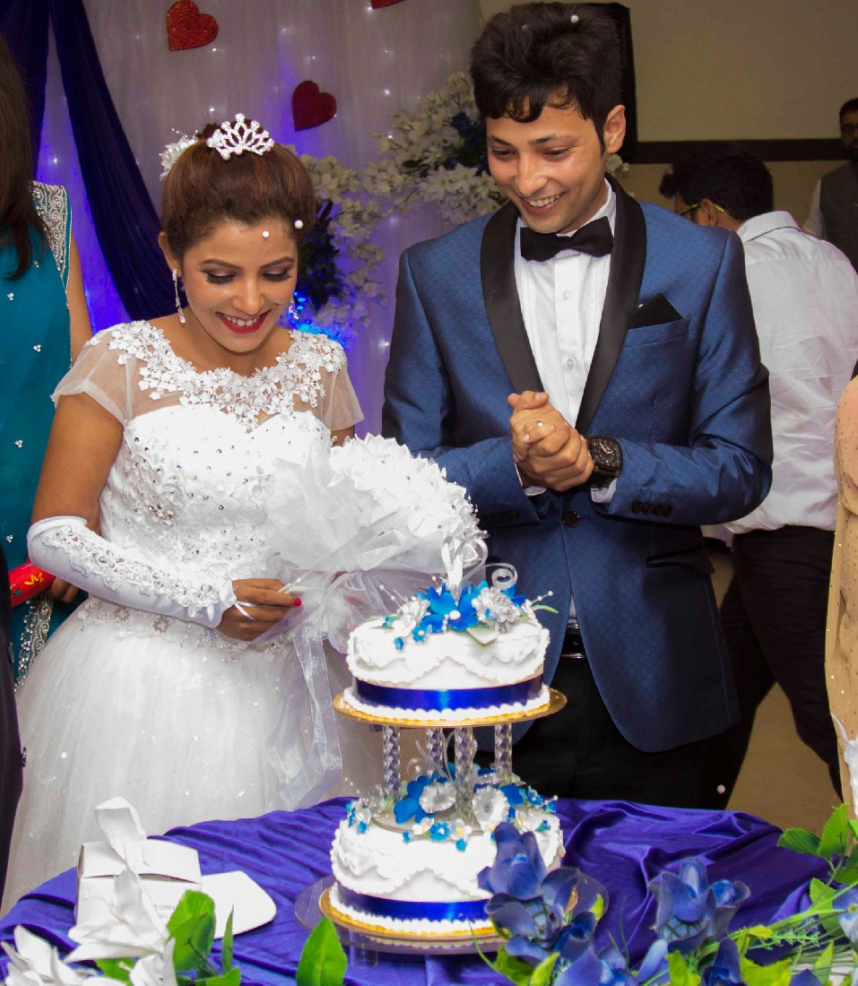Lets celebrate with a cake by Rahul Vadhs Photography Wedding-photography | Weddings Photos & Ideas
