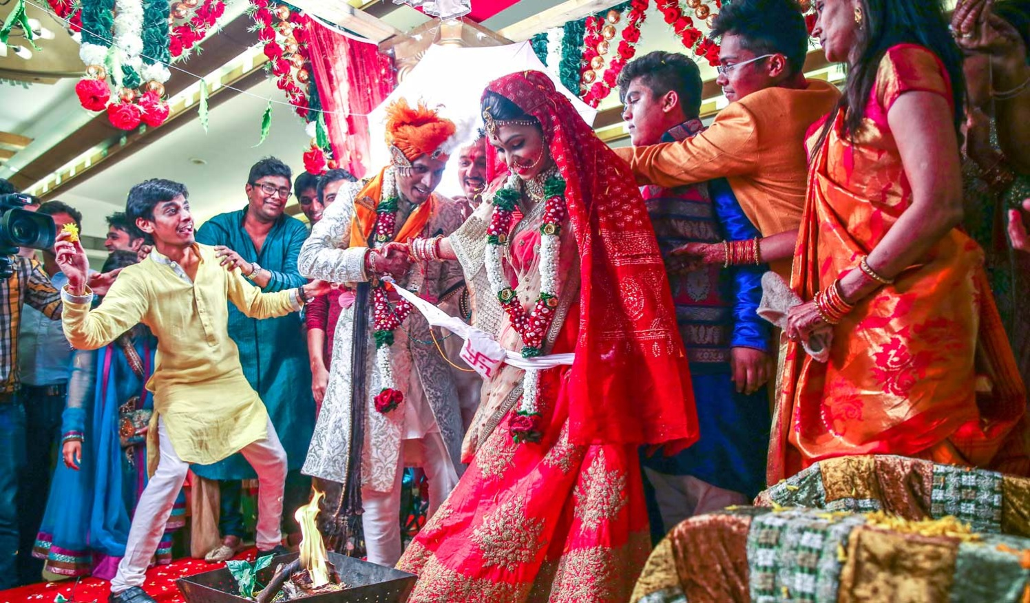 A candid picture of the family having fun during the wedding traditions. by Arya Arts Wedding-photography | Weddings Photos & Ideas