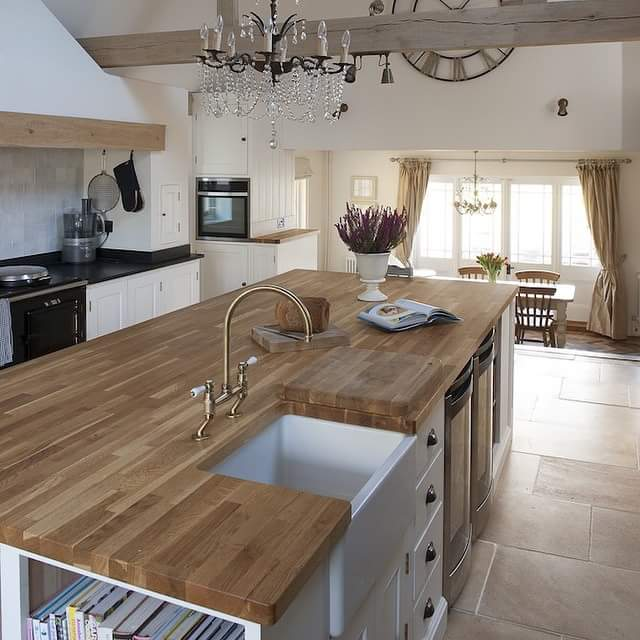 A wooden kitchen! by Makan interiors & decorators Modular-kitchen | Interior Design Photos & Ideas