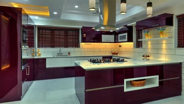A cherry coloured modular kitchen! by Pamin Patel Modular-kitchen | Interior Design Photos & Ideas