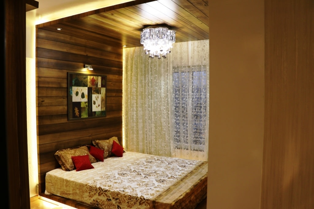Low Rise Wooden Bed With Hanging Chandelier by Rajat Ajmera Bedroom Contemporary | Interior Design Photos & Ideas