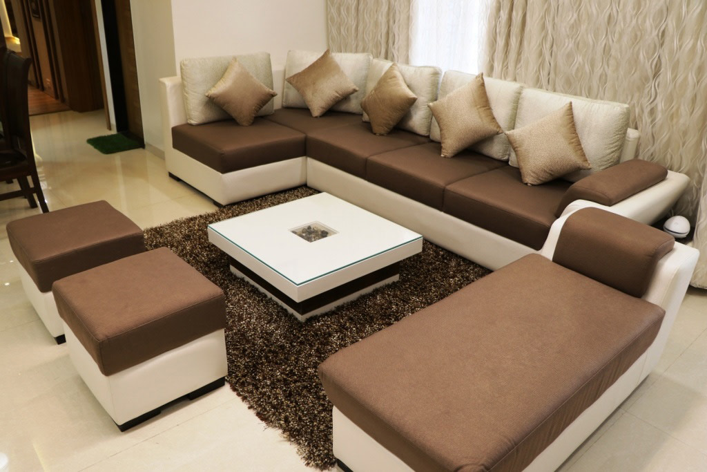 Brown Sectional Sofas With White Centre Table by Rajat Ajmera Living-room Minimalistic | Interior Design Photos & Ideas