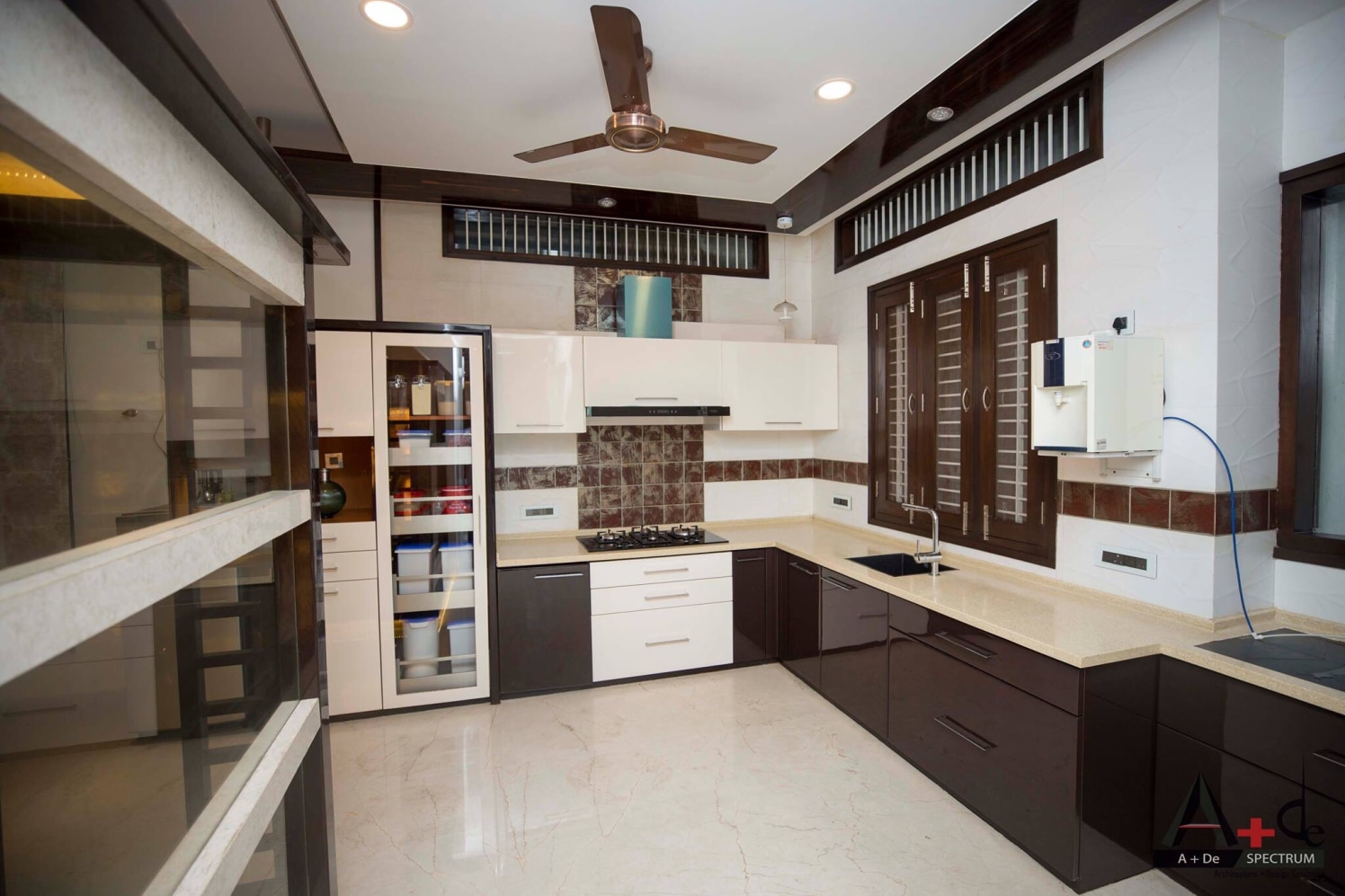 Standard Modular Kitchen With Brown And White Fiitings By A De Spectrum