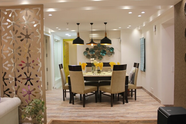 Neutral Tone Dining Room With Beige Cushioned Side Chairs by Shikhar Gupta Dining-room Modern | Interior Design Photos & Ideas