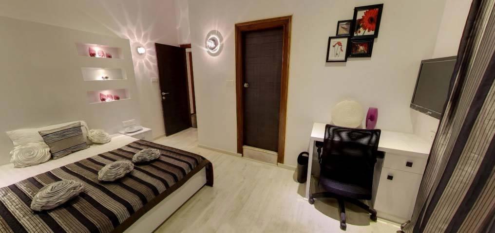 Contemporary bedroom with study table by De Panache Interior Architecture  Bedroom Contemporary | Interior Design Photos & Ideas