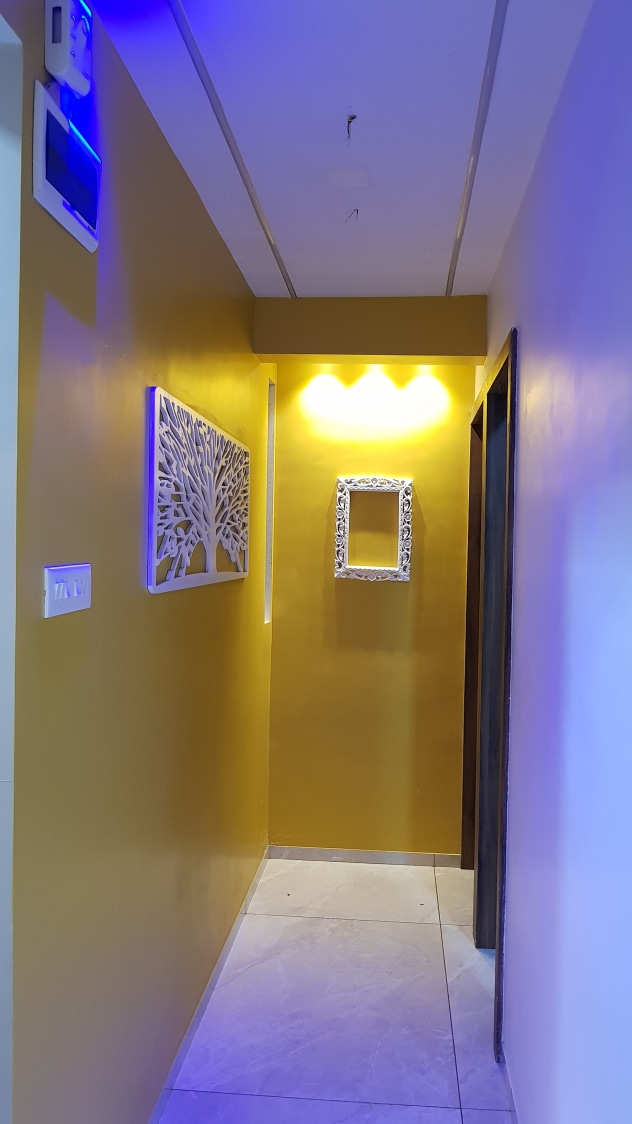 Yellow  and blue  shade Hallway by Alaya D'decor  Indoor-spaces Modern | Interior Design Photos & Ideas