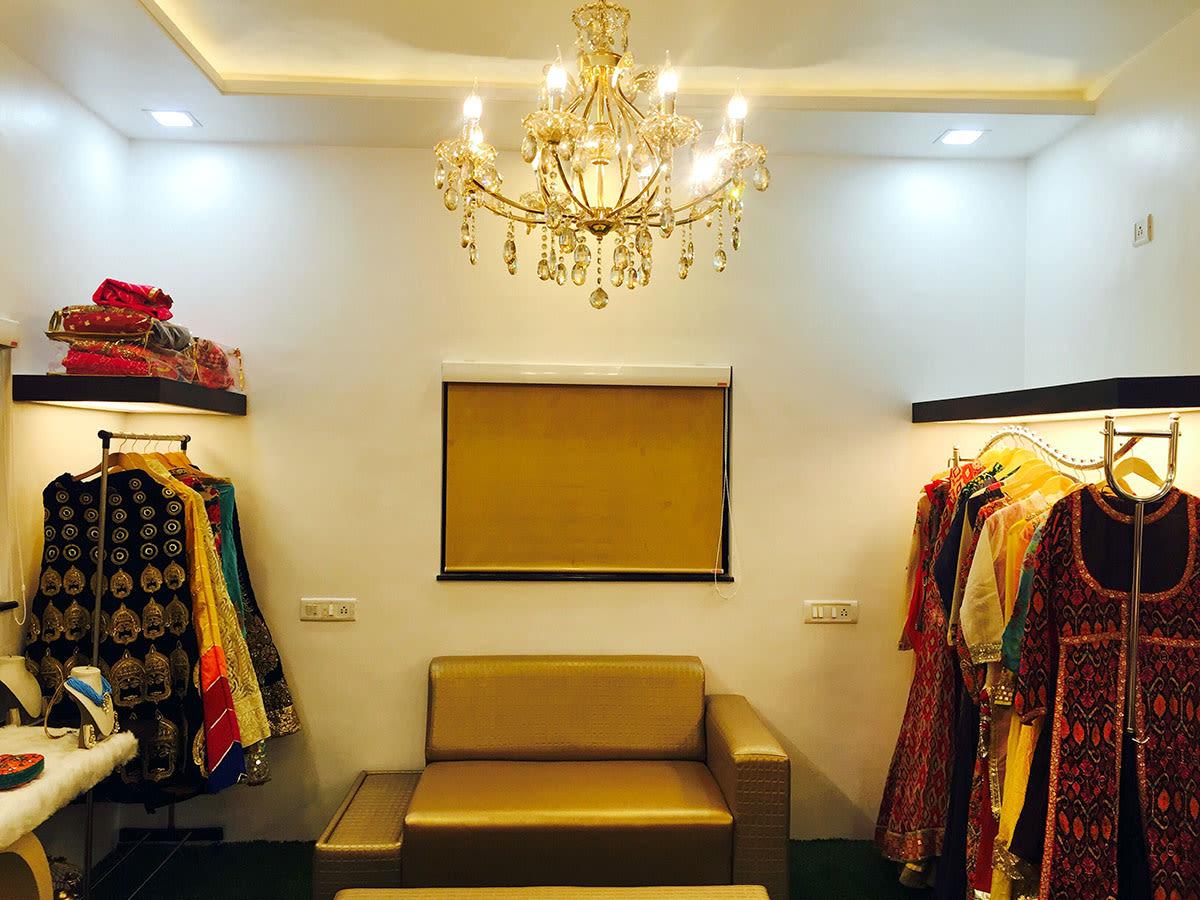 Vintage Designed Chandelier In A Showroom by Anshuma Vaidya Bora Modern | Interior Design Photos & Ideas