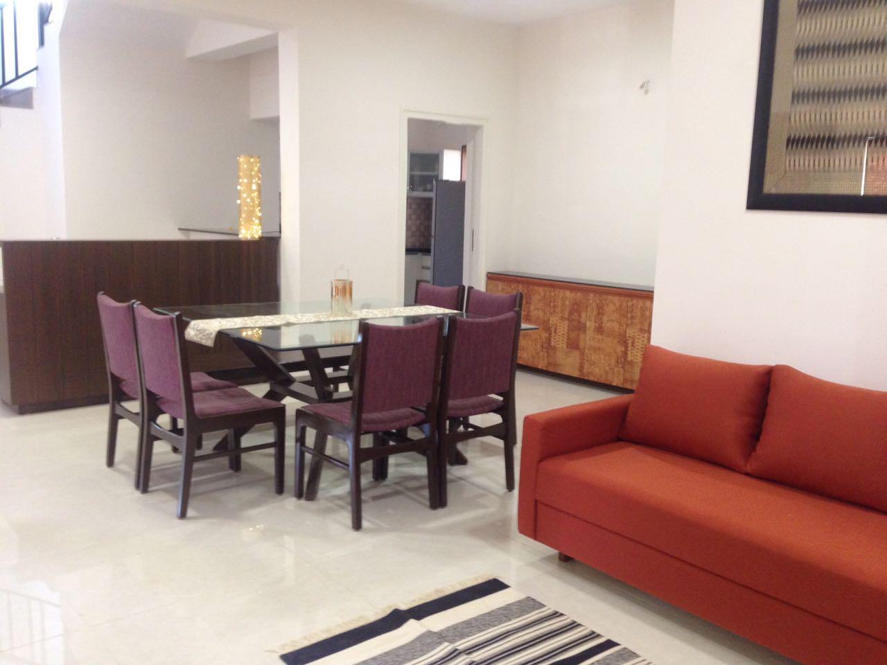 Dining Area With Loveseat Sofa And Mid Century Modern Dining Furniture by Aanoshka Choksi Dining-room Contemporary | Interior Design Photos & Ideas