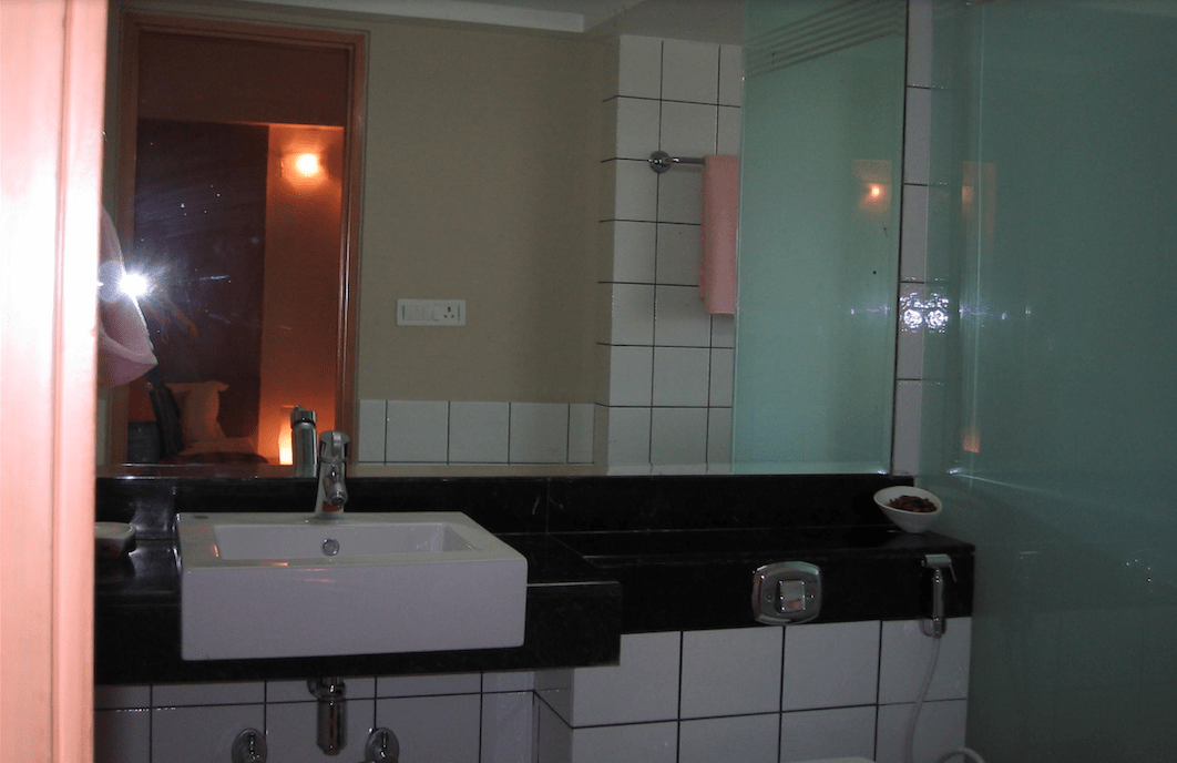 Bathroom With White Tiles And Large Mirror by INV Home Bathroom Contemporary   Interior Design Photos & Ideas