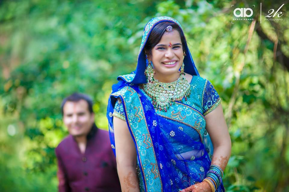 A happy bride on her wedding day. by Akash Anand Photography  Wedding-photography Bridal-jewellery-and-accessories | Weddings Photos & Ideas