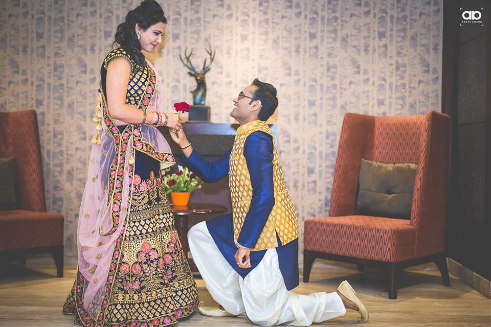 Groom on his knees proposing his girl. by Akash Anand  Wedding-photography Bridal-jewellery-and-accessories | Weddings Photos & Ideas