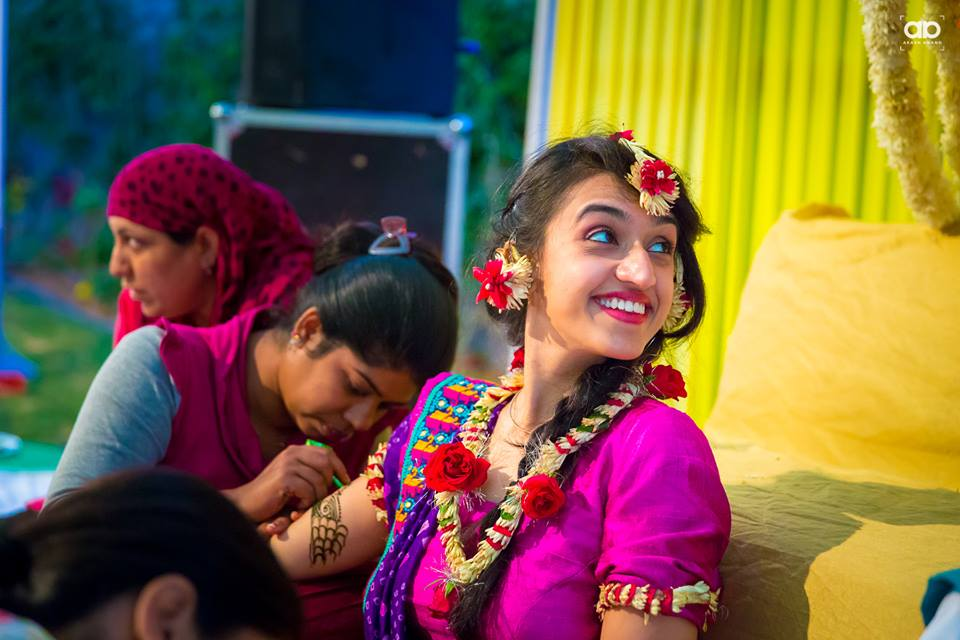 A happy bride on her mehendi function. by Akash Anand Photography  Wedding-photography Bridal-makeup | Weddings Photos & Ideas