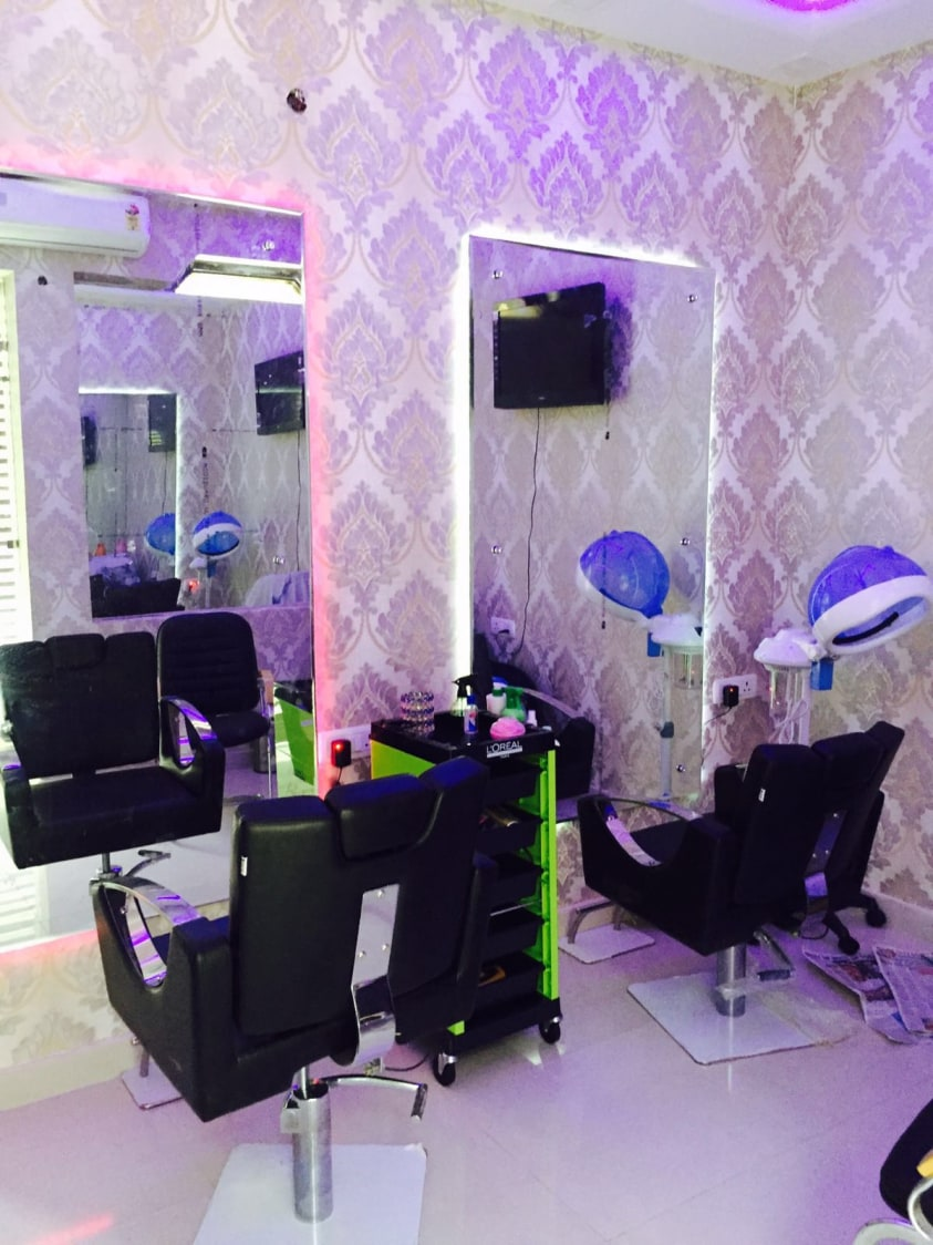 Salon With Black Revolving Chair And Purple Wallpaper by Arpit Khurana Contemporary | Interior Design Photos & Ideas