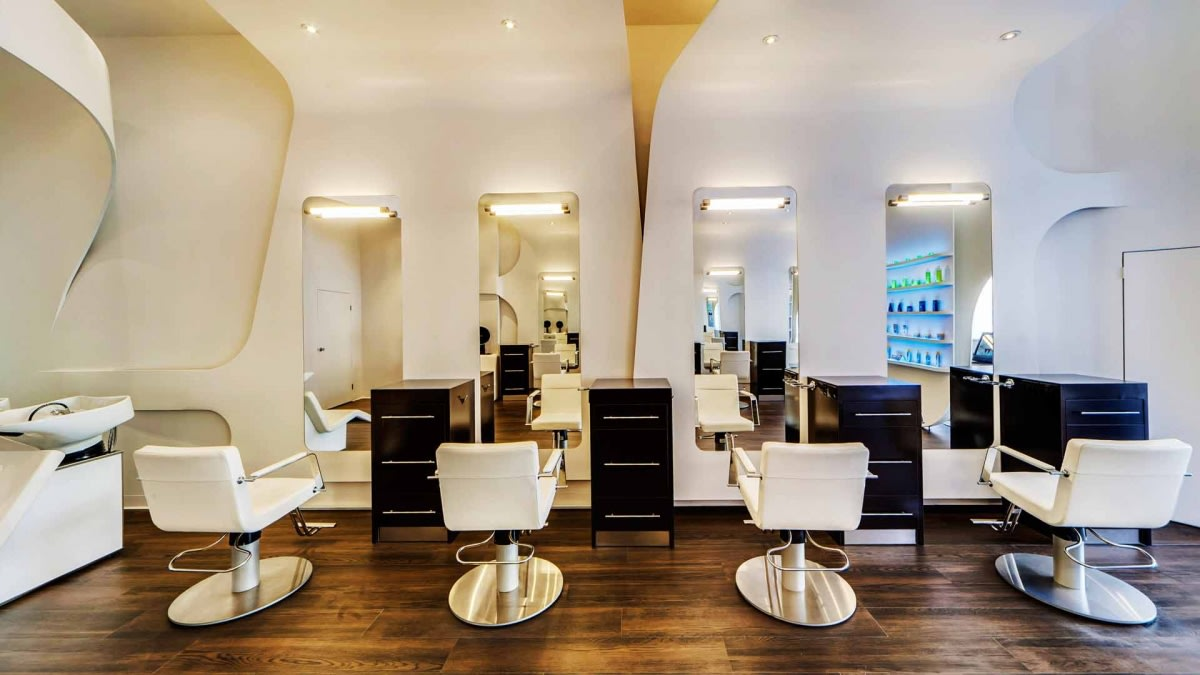 Wooden Flooring And White Round Chairs In Salon by Hemant Sahni Modern | Interior Design Photos & Ideas