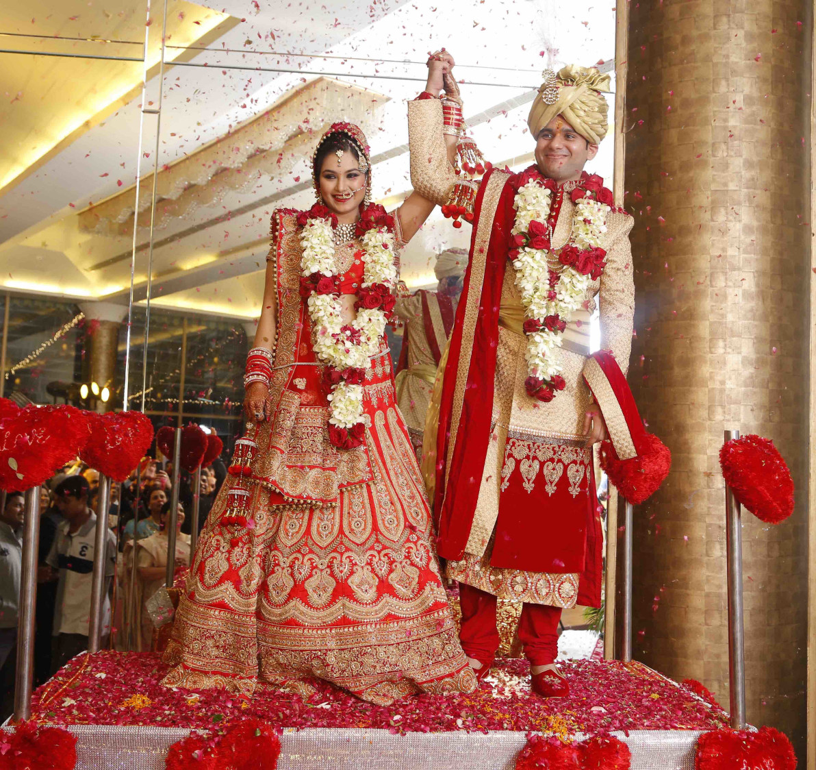 Crimson Red Bridal Lehenga  with Golden Motifs And Stunning Golden Scarlet Red Groom Sherwani by Ravneet Oberoi Wedding-photography Groom-wear-and-accessories Wedding-dresses | Weddings Photos & Ideas