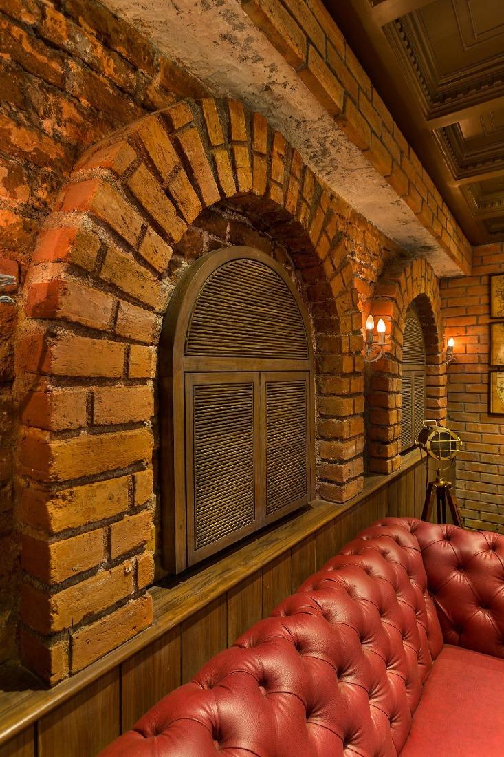 Brick Wall In the Cafe by Namah Design Studio  | Interior Design Photos & Ideas