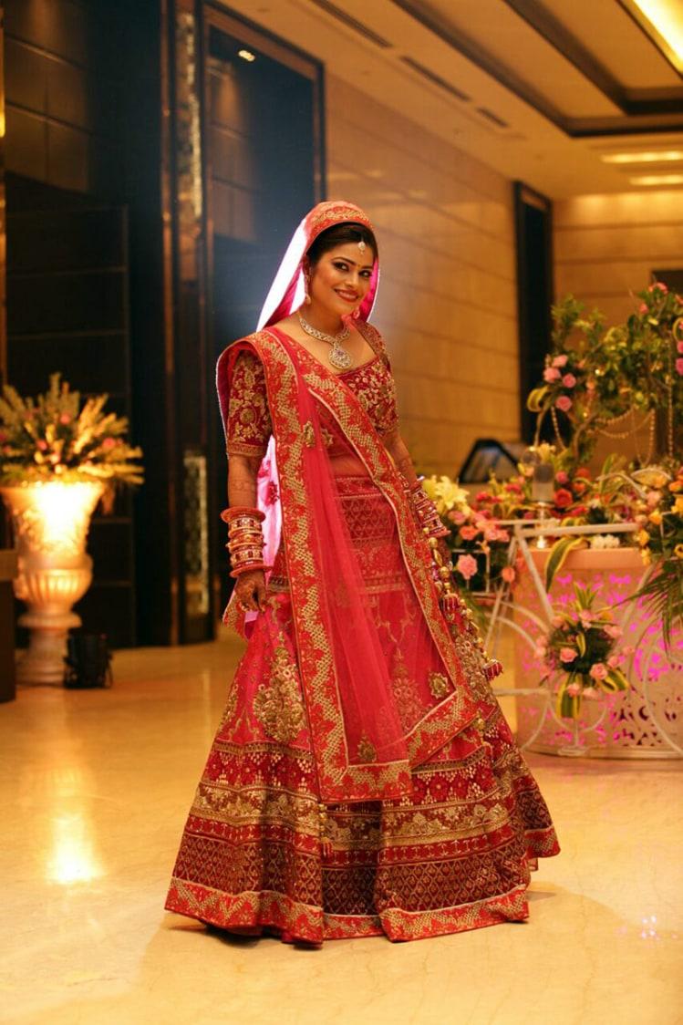 Splendid Bride Wearing Red Lehenga With Golden Embroidery by Preeti Sharma Wedding-photography Wedding-dresses | Weddings Photos & Ideas