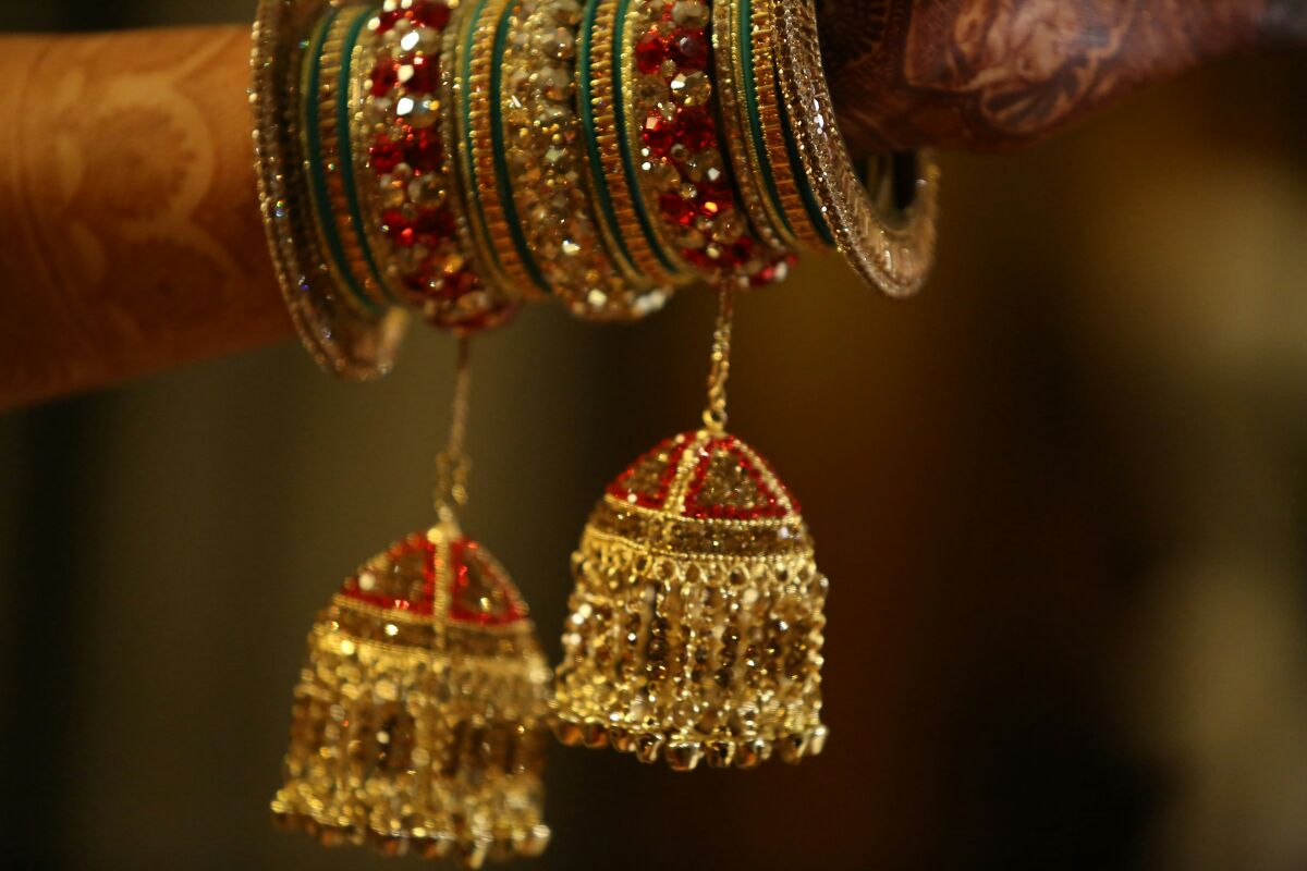 An armful of jewelry by Momento Perfecto Wedding-photography | Weddings Photos & Ideas