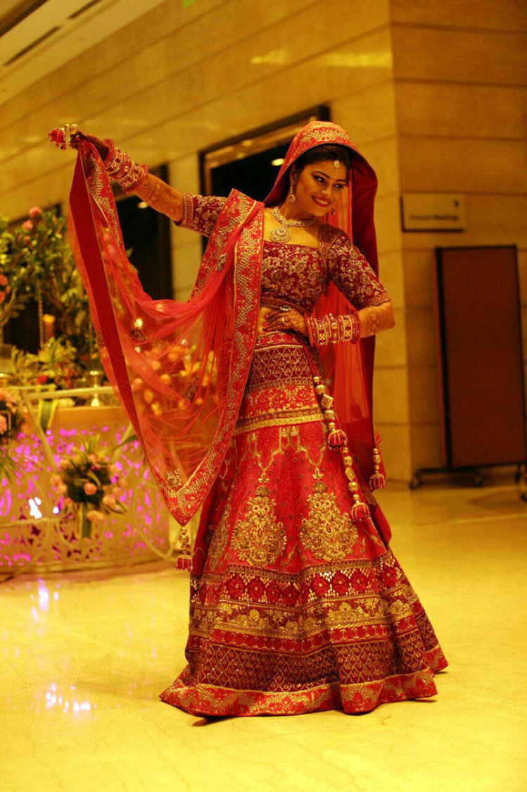 Splendid Bride Wearing Red Lehenga With Golden Embroidery by Preeti Sharma Wedding-photography Wedding-dresses | Weddings Photos & Ideas